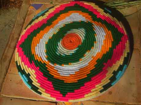 Colorful wool basket made from the Washingtonia palm