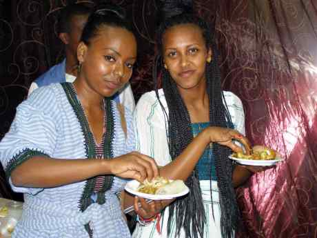 Young women eating Injera